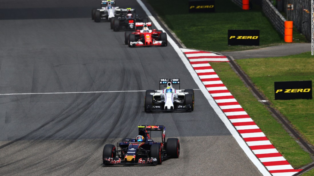 Carlos Sainz of Spain driving the (55) Scuderia Toro Rosso STR11 Ferrari 060/5 turbo leads Felipe Massa of Brazil driving the (19) Williams Martini Racing Williams FW38 Mercedes PU106C Hybrid turbo on track during the Formula One Grand Prix of China.