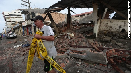 A man walks next to rubble at a street after a 7.8-magnitude quake in Portoviejo, Ecuador on April 17, 2016.  At least 77 people were killed when a powerful earthquake struck Ecuador, destroying buildings and a bridge and sending terrified residents scrambling from their homes, authorities said Sunday. / AFP / JUAN CEVALLOS        (Photo credit should read JUAN CEVALLOS/AFP/Getty Images)