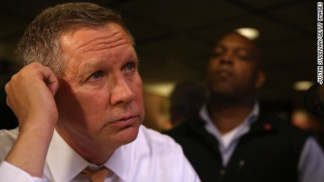 John Kasich talks with reporters after having lunch at PJ Bernstein's Deli Restaurant on April 16, 2016 in New York City.