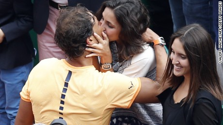 Sealed with a kiss: Nadal embraces his girlfriend Xisca Perello after winning in Monte CArlo for a record ninth time.