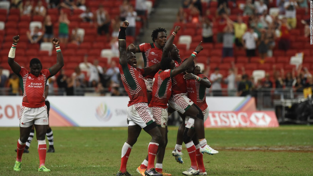 Kenya's players celebrate after beating Fiji during the cup final at the Singapore Sevens rugby tournament on April 17, 2016.