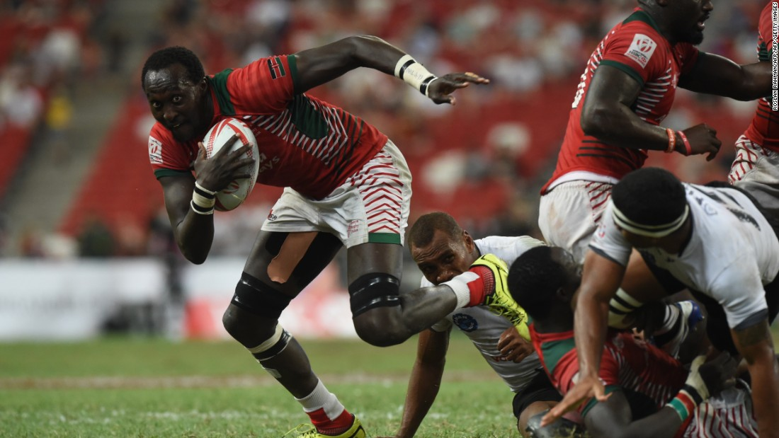 Kenya's Samuel Oliech (L) runs with ball during the cup final against Fiji at the Singapore Sevens rugby tournament on April 17, 2016.