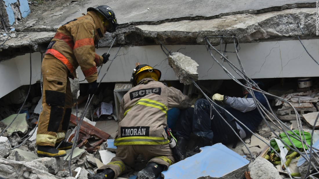 rescue workers search the rubble of a collapsed building for victims in guayaquil ecuador