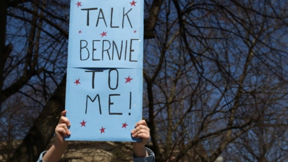 A Bernie Sanders supporter holds a sign at a small rally in Plattsburgh, New York on April 15, 2016.