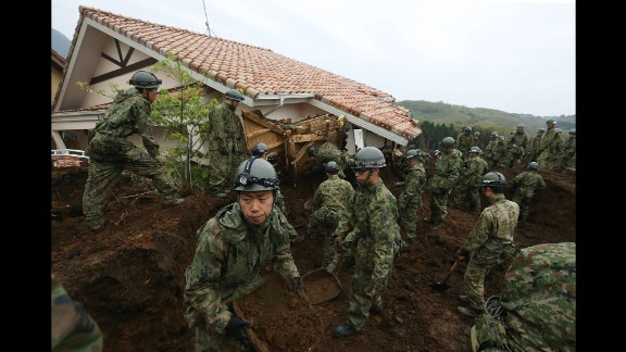 Japanese troops search for victims in Minamiaso on Monday, April 18.