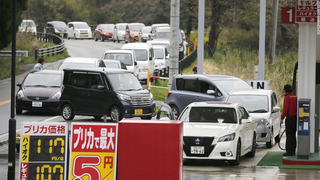 Vehicles line up to refuel at a gas station in Aso, Japan, on April 18.
