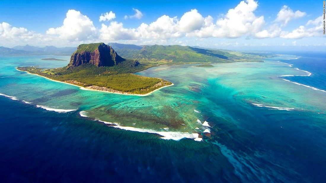 <strong>Underwater waterfall in Mauritius -- </strong>Just off the coast of Le Morne mountain lies what appears to be a vast subaquatic cascade. It is in fact a trick of the eye, caused by the formation of sand and silt on the ocean floor.