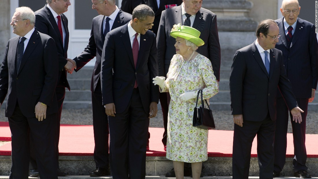 Queen Elizabeth II speaks with President Barack Obama during a group photo of world leaders attending the D-Day 70th Anniversary ceremonies at Chateau de Benouville in Benouville, France, on June 6, 2014.