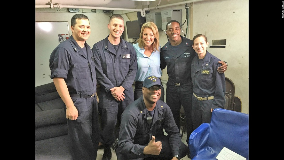 Several sailors pose with Brooke after their sit-down interview with her on guided missile cruiser USS Anzio.