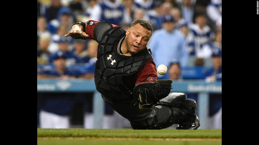 Arizona Diamondbacks catcher Welington Castillo dives to make a catch hit by the Los Angeles Dodgers' Yasmani Grandal during the eighth inning in Los Angeles on Wednesday, April 13.