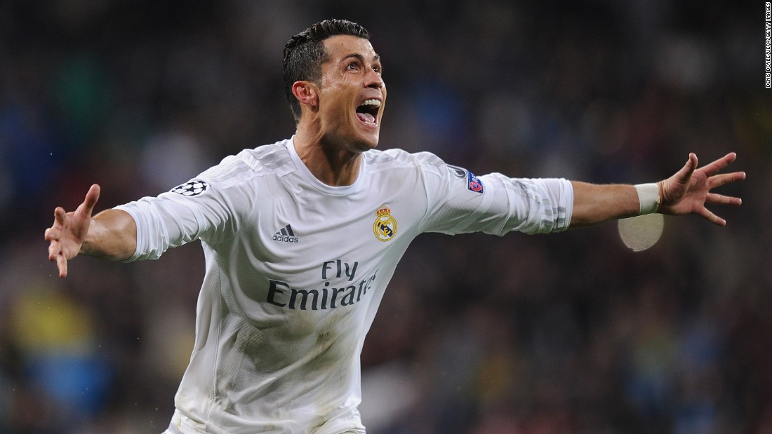 "Real Madrid's <a href=""http://edition.cnn.com/2016/04/12/football/real-madrid-champions-league-semifinals/index.html"">Cristiano Ronaldo celebrates scoring his third goal</a> during the UEFA Champions League Quarter Final Second Leg match against Wolfsburg at Estadio Santiago Bernabeu in Madrid on April 12."