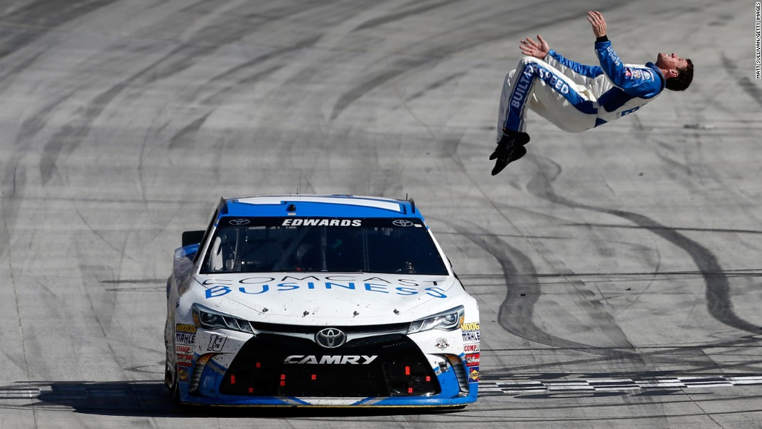 Carl Edwards, driver of the No. 19 Comcast Business Toyota, does a backflip from his car after winning the NASCAR Sprint Cup Series Food City 500 at Bristol Motor Speedway in Tennessee on April 17.