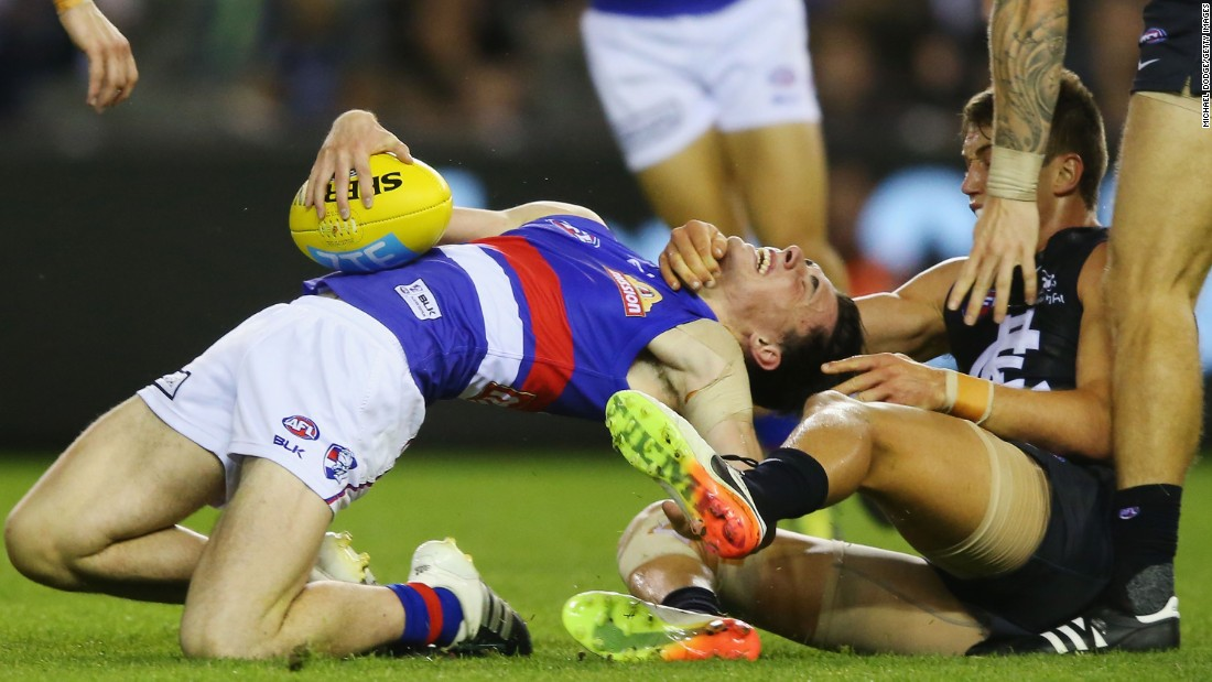 Toby McLean, left, is tackled by the throat by Patrick Cripps during an AFL Round 4 match between the Carlton Blues and the Western Bulldogs at Etihad Stadium in Melbourne, Australia, on April 16.