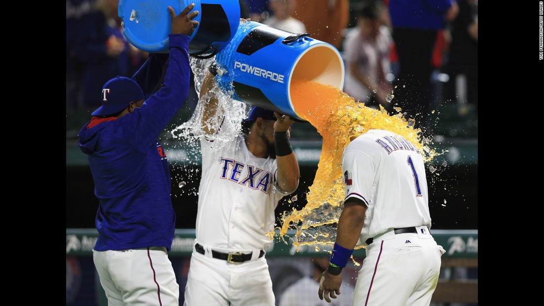 Hanser Alberto and Rougned Odor of the Texas Rangers celebrate with Elvis Andrus after the Rangers beat the Baltimore Orioles 6-3 at Globe Life Park in Arlington on April 14.