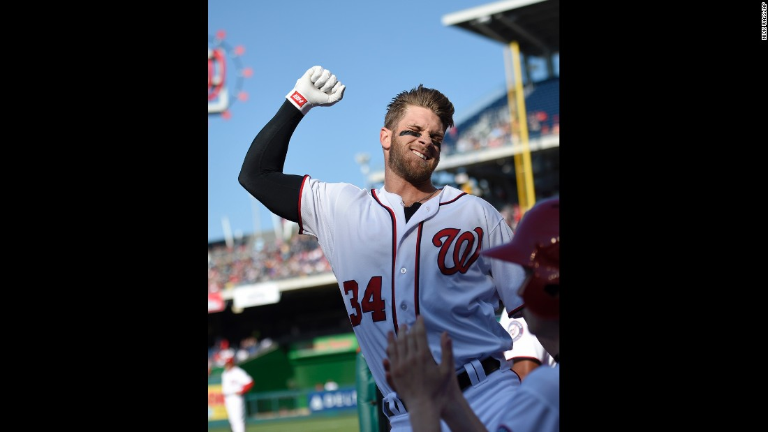 Washington Nationals' Bryce Harper pumps his fist after he hit a grand slam during the third  inning against the Atlanta Braves on Thursday, April 14, in Washington. This was Harper's 100th home run of his career.
