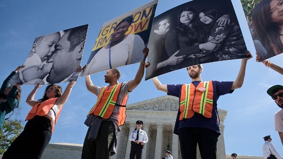 Supporters of immigration reform rally outside the US Supreme Court during arguments in United States vs Texas April 18, 2016 in Washington, DC. Hundreds of protesters rallied Monday outside the US Supreme Court as it weighed a major immigration case that could impact the fate of millions of people facing possible deportation and further raise the stakes in the 2016 White House race. / AFP / Brendan Smialowski        (Photo credit should read BRENDAN SMIALOWSKI/AFP/Getty Images)