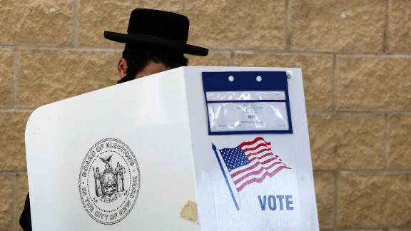 A man casts his vote at a polling station in Brooklyn, in the presidential primary for the state of New York April 19, 2016.