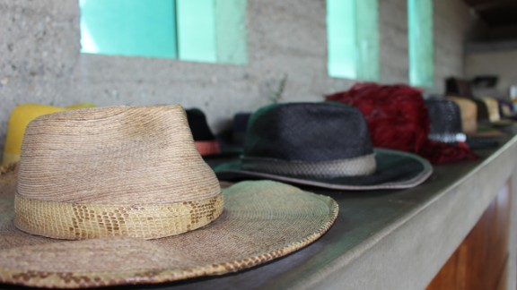 Never spotted without a hat, Goldstein displays a custom-designed collection by the walls of his bedroom. Glass windows above the hats peer into the architectural marvel