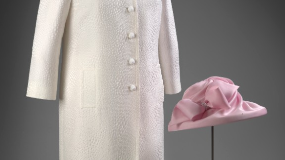 Pink silk dress with white jacquard coat designed by Stewart Parvin, and pink hat by Philip Somerville, worn to a garden party.