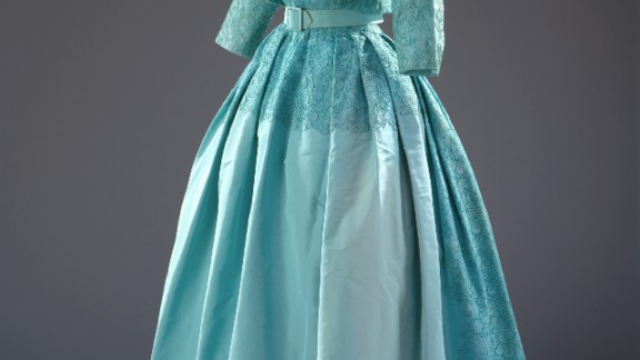 Turquoise dress with a matching bolero jacket of silk taffeta, guipure lace and silk tulle by Norman Hartnell, worn to Princess Margaret