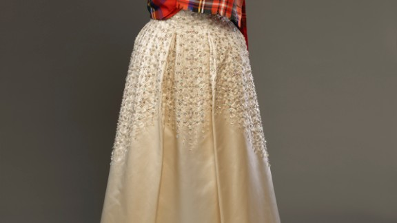 Evening dress by Norman Hartnell with a sash of Royal Stewart tartan, worn to the Gillies Ball at Balmoral Castle.