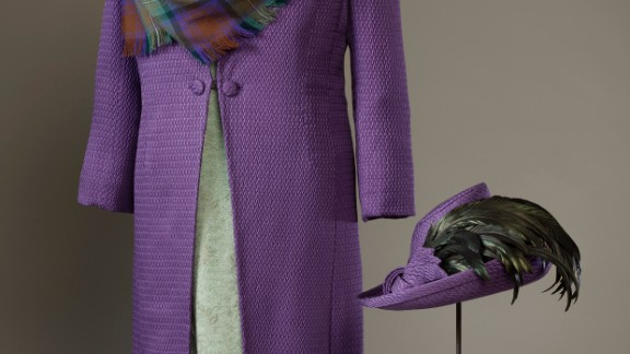 Purple silk-wool coat with a green silk-crepe and lace dress, and a shawl of purple and green Isle of Skye tartan by Sandra Murray, worn to the official opening of the Scottish Parliament on July 1, 1999.