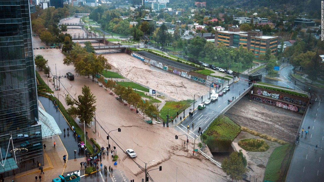 The Mapocho River overflows during heavy rain in Santiago, Chile, on Sunday, April 17.