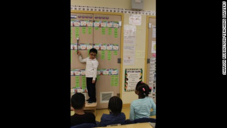 A student at P.S. 94 practices sight words with his classmates.