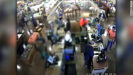 A screen grab of Whole Foods security footage, released by the company in April, showing the moment the cake was purchased. Brown is pictured on the far right.