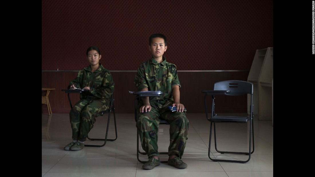 Two boys attend class at a military-style boot camp in Jinan, China. Photographer Lorenzo Maccotta spent about a week at the treatment center, one of hundreds for young people who are addicted to technology -- mostly online gaming.