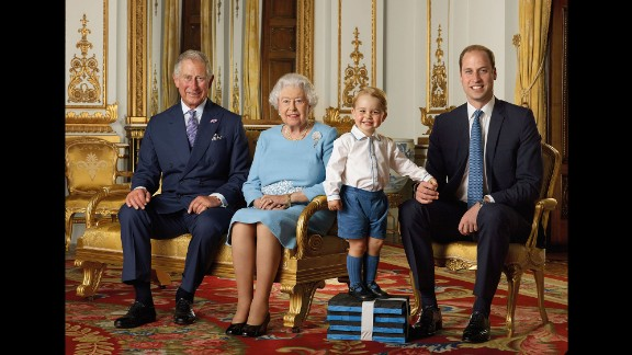 Prince George gets a boost from some foam blocks for a special family photo in April 2016. The portrait, featuring the four generations of the House of Windsor, was commissioned by the Royal Mail and would be featured on a series of stamps to commemorate the Queen