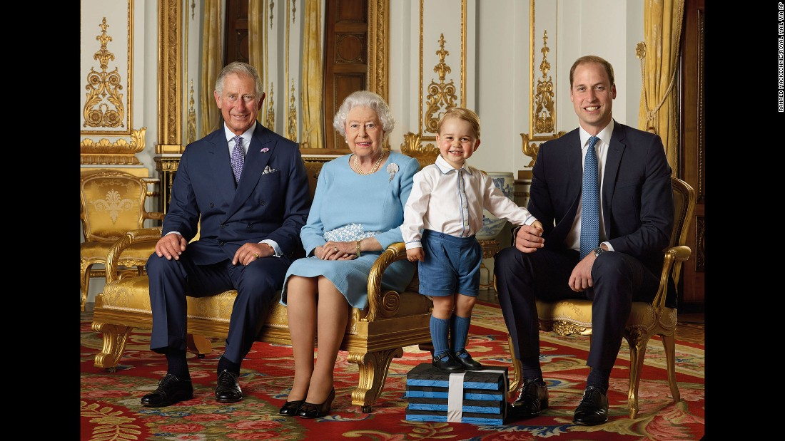 Prince George gets a boost from some foam blocks for a special family photo. The portrait, featuring the four generations of the House of Windsor, was commissioned by the Royal Mail and were featured on a series of stamps to commemorate the Queen's 90th birthday in 2016.