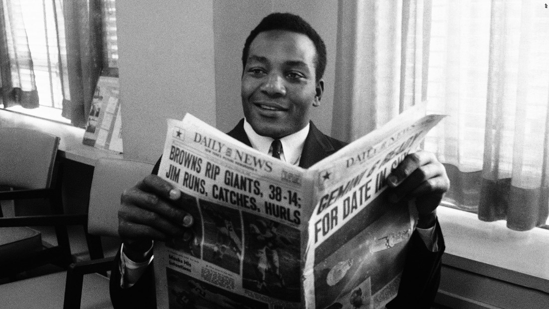 Cleveland fullback Jim Brown, seen here reading a story about himself in the New York Daily News in 1965, retired from the NFL in 1966 at age 30. Brown played for the Cleveland Browns for nine seasons, winning the NFL championship in 1964, the last year the city of Cleveland won a major championship. Brown was a nine-time Pro Bowler and was inducted into the Pro Football Hall of Fame in 1971.