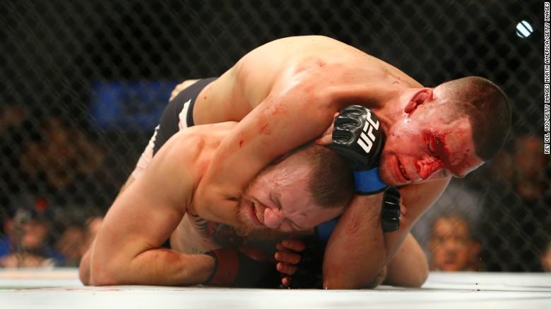 Nate Diaz chokes Conor McGregor at UFC 196.
