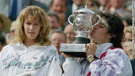 Arantxa Sanchez Vicario of Spain kissing the trophy after winning the ladies singles final of the French Open Tennis Championships held at Roland Garros, Paris, France during June 1989.  She beat Steffi Graf (left) 7-6, 3-6, 7-5.   (Photo by Bob Thomas/Getty Images).