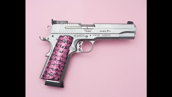 Photographers Miguel Hahn and Jan-Christophe Hartung were surprised by the scale of gun ownership in the country. So they set out to document it. The pistol pictured here is owned by a young woman.