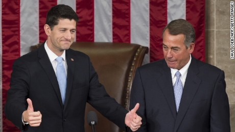 Newly elected Speaker of the House Paul Ryan, Republican of Wisconsin, (L) gives thumbs-ups alongside outside Speaker John Boehner, Republican of Ohio, after being elected Speaker in the House Chamber at the US Capitol in Washington, DC, October 29, 2015.