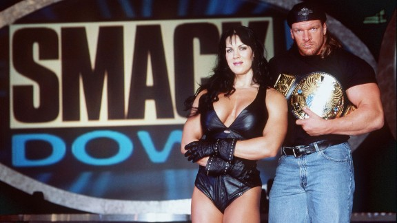 Chyna and wrestler Triple H pose for a photo in 1999.