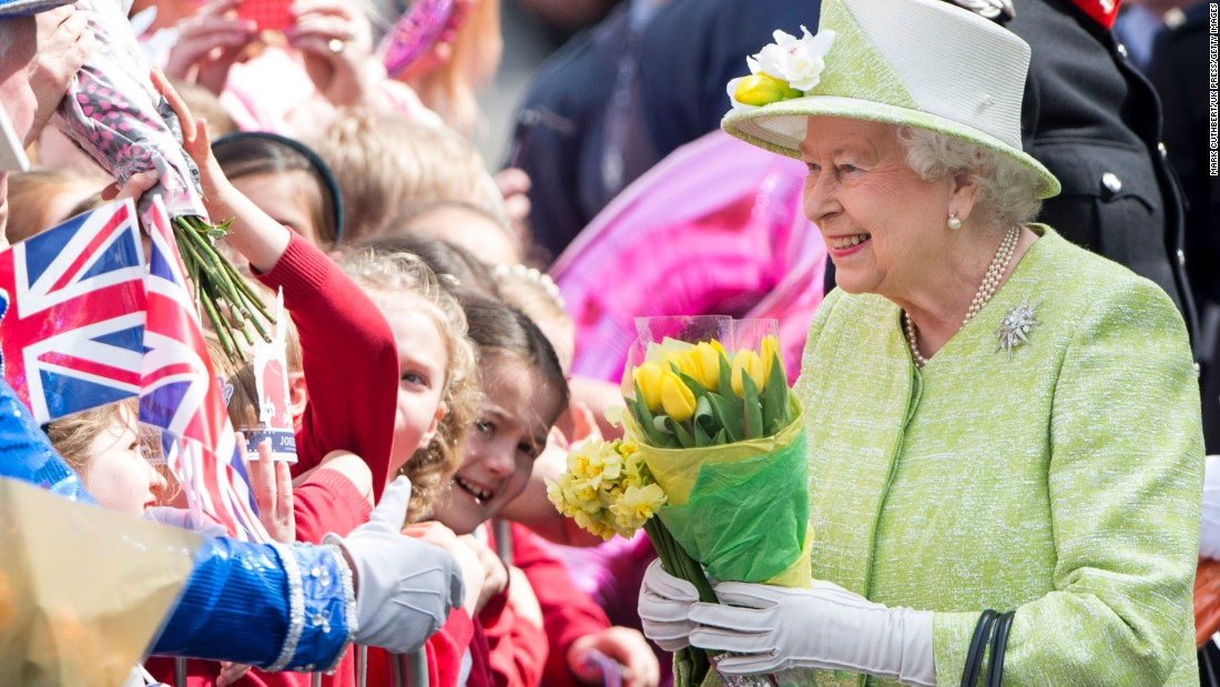 Queen Elizabeth II Acknowledges The Crowd As She Celebrates Her 90th Birthday In Windsor