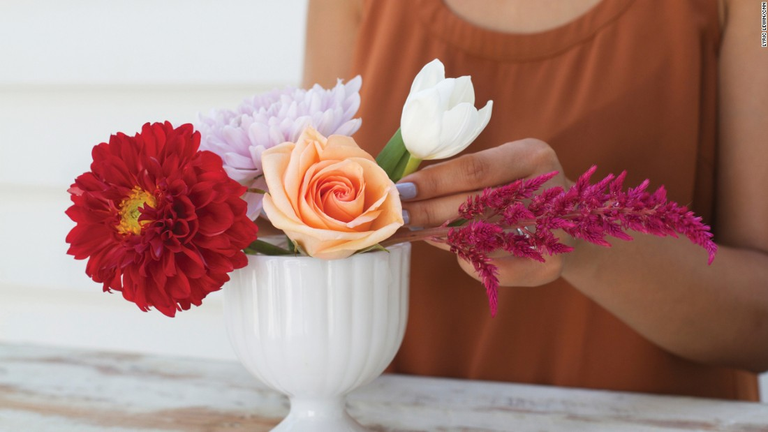 Next, add other big blooms to compliment the first one.