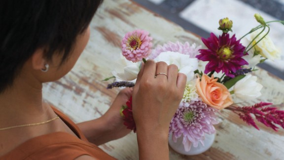 After you've added your focal point flowers, then fill in empty spots with filler flowers.