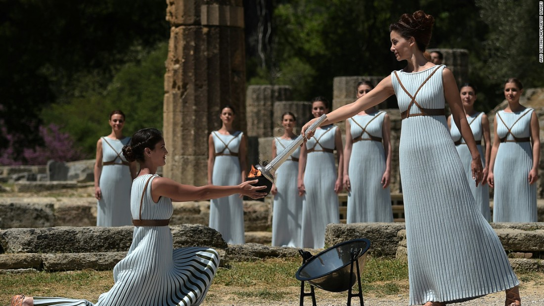 Lechou passes the Olympic flame into a small ceramic bowl. The ceremony was performed at  sc 1 st  CNN International & Olympics 2016: Torch begins journey to Brazil - CNN