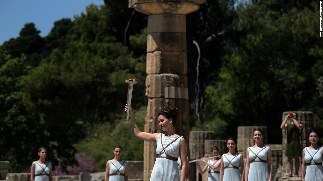 The traditions of the torch-lighting ceremony, which include playing of the ancient Greek instrument the lyra and the release of a white dove for peace, were established at the Berlin Games in 1936.