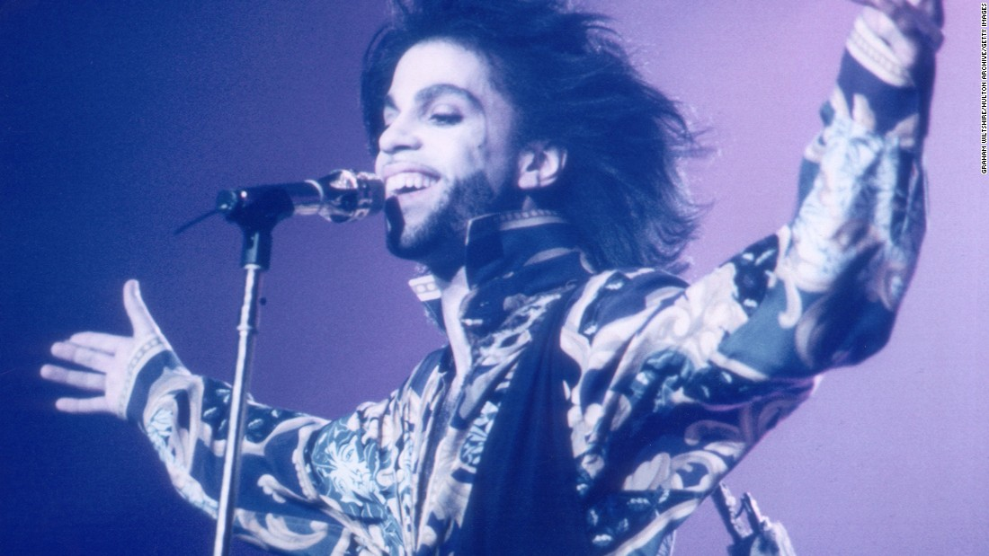 "The singer's predilection for lavishly kinky story-songs earned him the nickname ""His Royal Badness."" He is also known as the ""Purple One"" because of his colorful fashions. He is seen here in 1990."