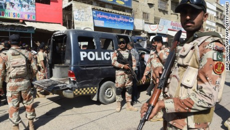 Pakistani security personnel gather around a police van after an attack by gunmen on security members guarding a polio vaccination team in Karachi on April 20, 2016.   Gunmen on motorcycles on April 20 shot dead seven policemen guarding a polio vaccination team in Pakistan's southern port city Karachi, officials said, a brazen attack in the country's economic hub. Feroz Shah, a senior police official told AFP that eight gunmen carried out the killings in two separate attacks in the city's western Orangi Town neighbourhood. / AFP / ASIF HASSAN        (Photo credit should read ASIF HASSAN/AFP/Getty Images)