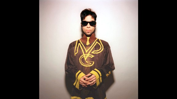 Prince poses for a photo in Toronto in 1996.