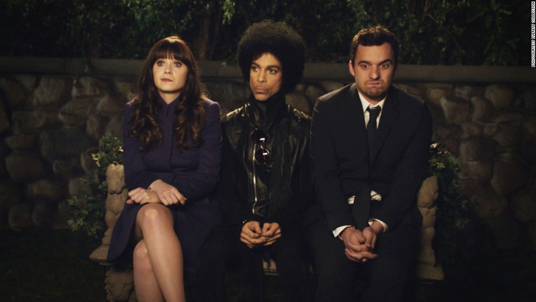 "Left to right: Zooey Deschanel, Prince, and Jake Johnson in a scene from the TV show ""New Girl"" which aired in 2014."