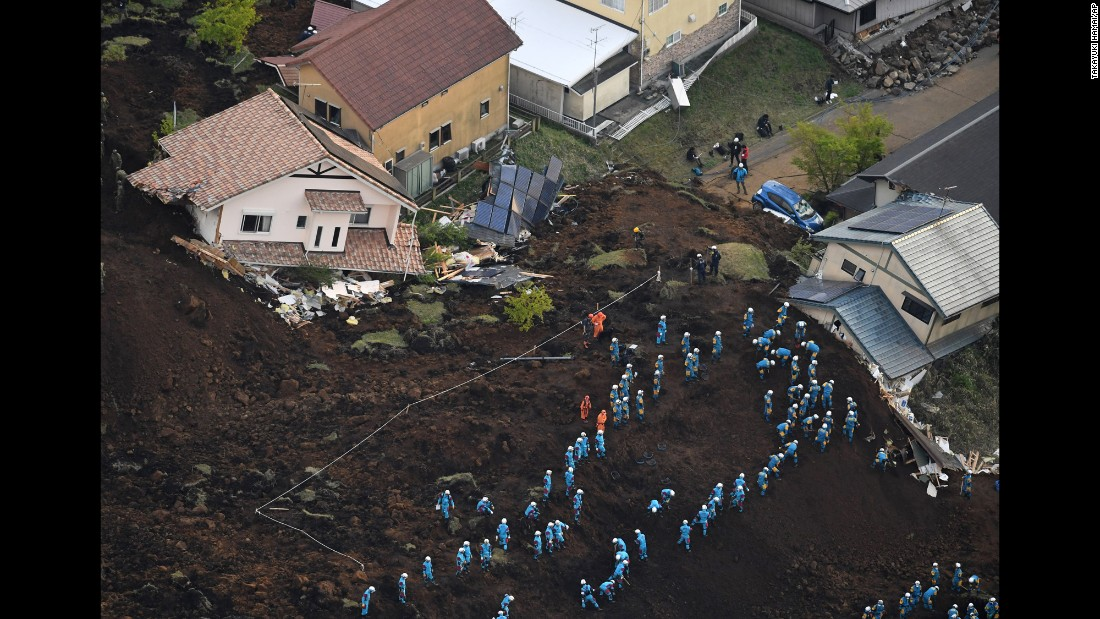 "A photo shows Self-Defense Forces personnel and other rescue workers searching for missing people in a residential area of Kumamoto, Japan, on Sunday, April 17. <a href=""http://www.cnn.com/2016/04/16/asia/japan-earthquake/"" target=""_blank"">The magnitude-7.0 earthquake</a> that pounded Kumamoto Prefecture early Saturday was more powerful than a foreshock that struck two days earlier."