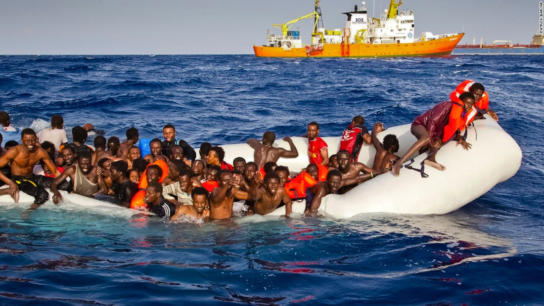 On Sunday, April 17, migrants ask for help from a dinghy boat off the coast of the Italian island of Lampedusa.