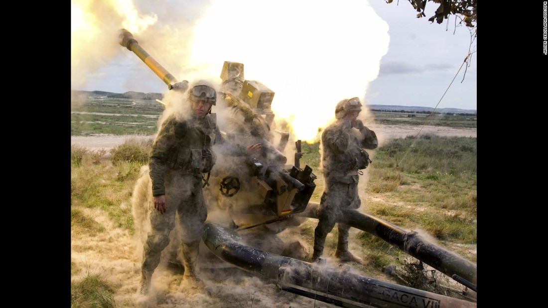Spanish soldiers fire a howitzer during maneuvers ' in preparation to NATO's Very High Readiness Joint Task Force in Zargoza, Spain, on Tuesday, April 19.
